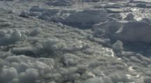View Looking Down From Boat Traveling Through Melt Ice, Tilt To Shoreline