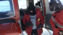 Passengers Disembark From Helicopter On Ice Field
