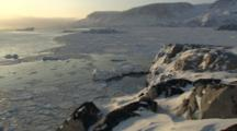 Frozen Arctic Landscape Of Rugged Greenland Coast