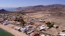 Aerial Approaching And Travel Over Coastal Resort Community