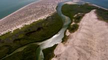 Aerial Over Wetlands Between Desert And Shoreline