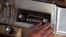 Person Turns Old-Fashioned Radio Knob