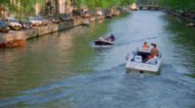 People Ride In Boats On Dutch Canal