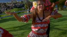 Young Woman Performs Hula Accompanied By Musicians