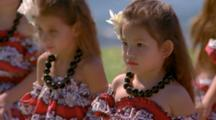 Woman Leads Young Girls In Hula Class At Edge Of Ocean