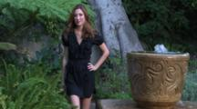 Female Model Poses Next To Fountain
