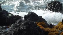 Waves Wash Up On Rocky Shore