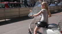 Woman on motor bike