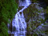 Waterfalls Cascading To End In Fjord