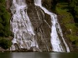 Waterfall Cascading Into Fjord