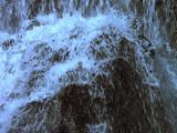 Cascading Waterfall Creates Rainbow