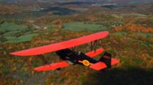 Aerial Of Bi-Plane Flying Over Forest, Countryside, Autumn Colors