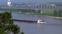 Tugboat Pushes Barge