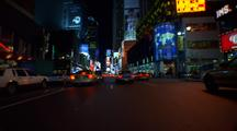 Bike Messenger, Rides His Bike Through The Traffic In Times Square At Night