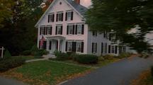 House In New England With Autumn Colors On Trees