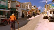 Old Man Walks Down Small Town Street