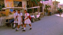 School Girls Walk Down Road