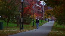 Students Walk Past The Campus Building