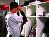 Baseball Player Dressing In Locker Room