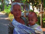 Old Woman Holding A Child
