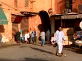 People Walk About North African Town