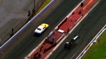 Aerial As Two Automobiles Wait At Starting Line On Race Track