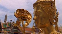 Ornate Buildings And Gold Statue At Grand Palace In Bangkok