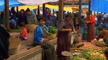 Pan Over Produce At Stand Of Owner Who Paces