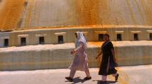 Women Walking Past A Stupa In Nepal