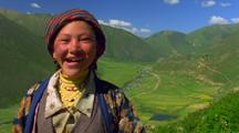 Laughing Woman Overlooking A Himalayan Valley