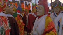 A Parade In Nepal With People In Traditional Costume