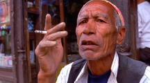 Village Man Smoking In Nepal
