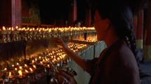 People Lighting Temple Candles In Nepal