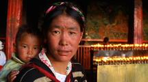 Mother And Child In A Temple In Nepal