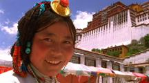 Smiling Woman With White Palace In Background