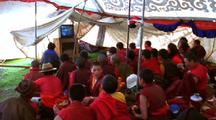 Buddhist Monks Watch Television In A Tent