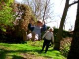 Senior Woman Pushes Boy On Swing
