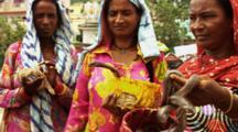 Women Hold Snakes