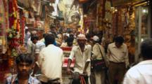 Pedestrians And Vendors In Busy Market
