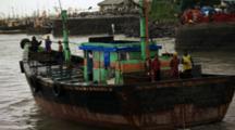 Colorful Boat Leaves City Marina
