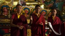 Young Monks Pose In Front Of Buddhist Altar