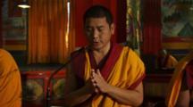 Buddhist Monks Pray In Monastery