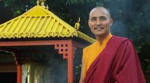 Buddhist Monk Near Shrine