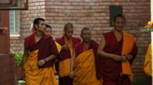 Group Of Monks Leave Buddhist Monastery