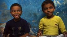 Two Boys Pose Doing Homework