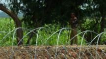 Soldier Near Barbed Wire Fence