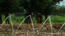 Soldiers Near Barbed Wire Fence