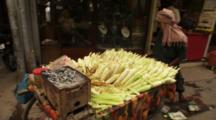 Vendor In Market Pulls Cart With Corn For Sale