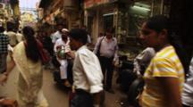 Pedestrians Walk In Crowded Market