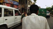 Man Drives Pedicab Down Busy Street
